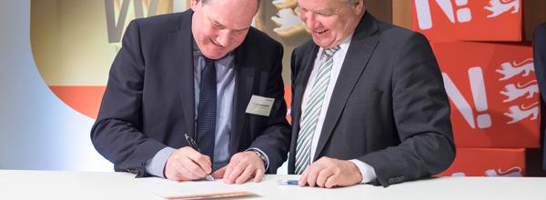 Unterzeichnung der WIN-Charta